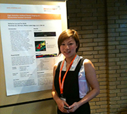 Application Scientist Katherine Lau with presentation poster